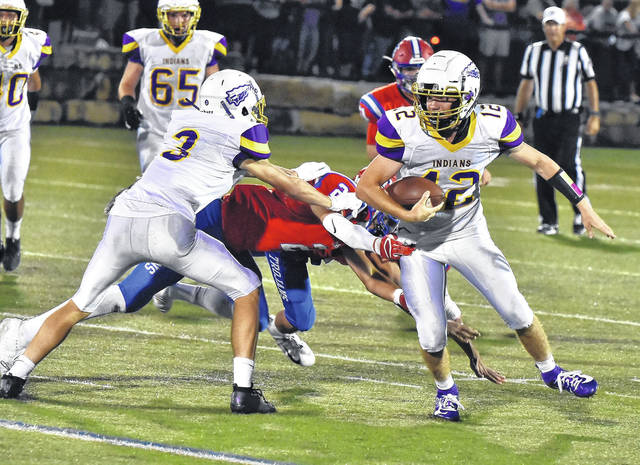 Valley quarterback Andrew Andronis (12) gets a block from wide receiver Ty Perkins (3) during the Indians' season-opening football game at Portsmouth last season.