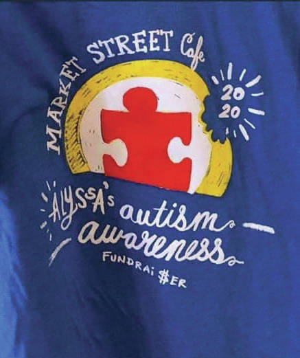 A photo of the emblem for the shirts Alyssa sold for the Autism Project.
