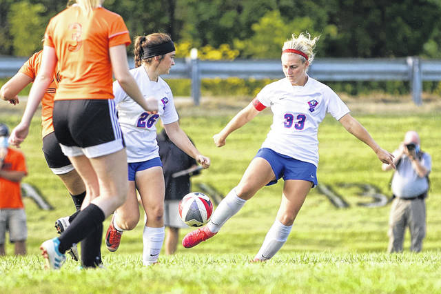 Northwest senior Jaclyn Burchett and Olivia Chambers go for possession in the Lady Mohawks' 1-1 tie versus West on Wednesday.