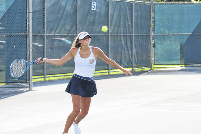Notre Dame's Isabel Cassidy competes at first singles during the Lady Titans' tennis match against Wheelersburg on Tuesday at Shawnee State University.
