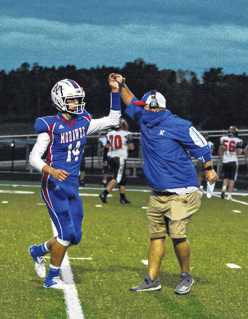 Northwest quarterback Austin Newman (14) and head coach Bill Crabtree celebrate following a Mohawk touchdown in the team's 42-20 victory over the Eastern Eagles.