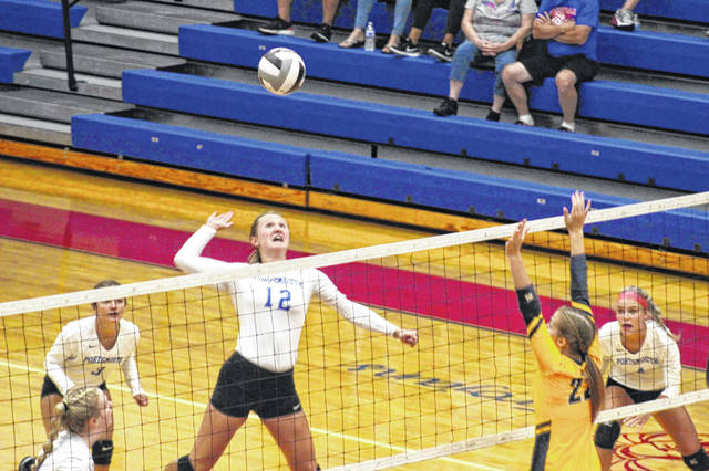 Portsmouth junior Maddie Perry attempts a kill during the Lady Trojans' three-set win over South Point in Ohio Valley Conference play.