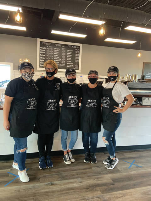 Employees with one of the owners (l to r) Maribeth Thompson, Kim Jarvis, Makenzie Marx, Tammy Salmons, Amber Kennedy inside Adams Flying Pig.