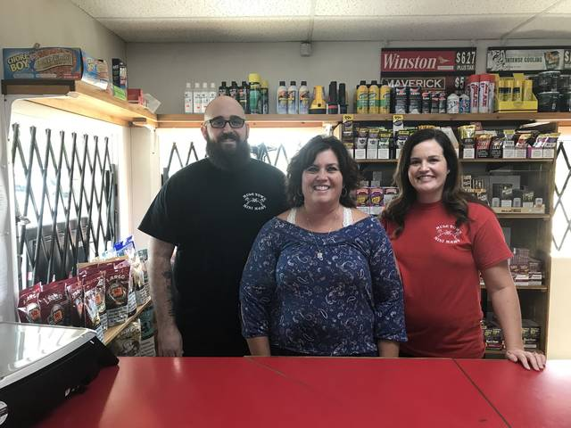 The Muletown Mini Mart has been in business and within the Blackburn family since 1984. Pictured left from right: David Dowdy, Crystal Stiltner, and Amber Pate.