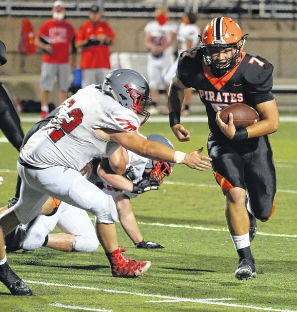 Wheelersburg's Kenny Sanderlin secures additional yardage during a run against Minford in their Southern Ohio Conference Division II football game two weeks ago at Ed Miller Stadium.