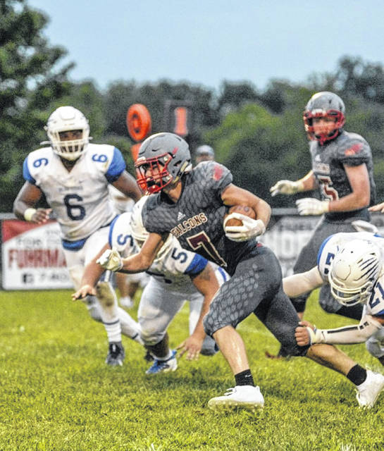 Minford's Matthew Risner (7) recorded four touchdown receptions in the Falcons' 26-25 season-opening win over Washington Court House last Friday night.