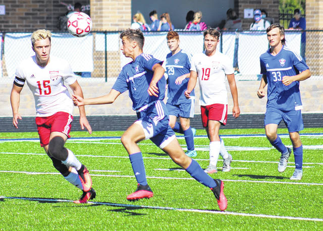 Minford senior Skyler Knore (15) and Northwest freshman Jay Jenkins (1) go for possession of the ball during Saturday's Southern Ohio Conference Division II boys soccer match at Northwest High School's Roy Rogers Field.