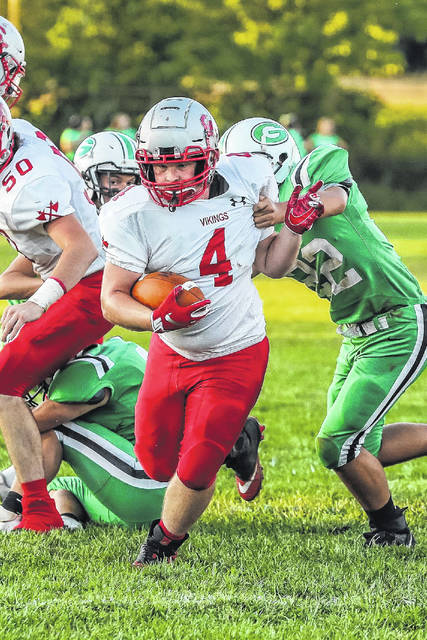 Green freshman Nathaniel Brannigan (22) attempts a tackle on Symmes Valley senior running back Derek Crum (4) in the Bobcats' home loss to the Vikings on Friday.