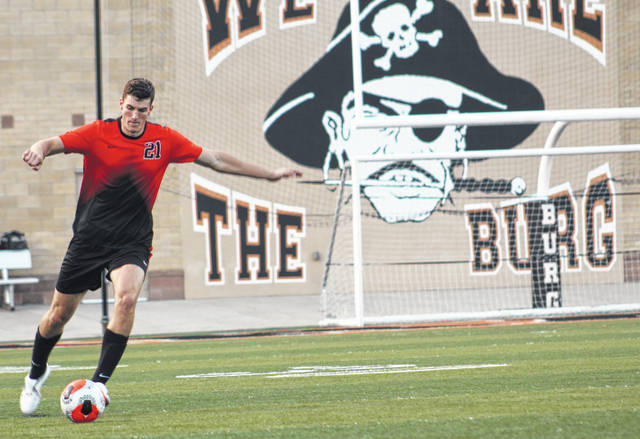 Wheelersburg senior Carter McCorkle (21) clears the ball during the Pirates' Southern Ohio Conference Division II boys soccer match against South Webster on Tuesday night at Wheelersburg's Ed Miller Stadium.