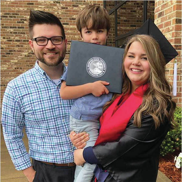 2018 Shawnee State graduate Keri Bentley is joined by husband Reese and son Kaiden after her ceremony. Since her graduation with an English Generalist degree, Keri has found successful employment in banking and now works as a compliance officer.