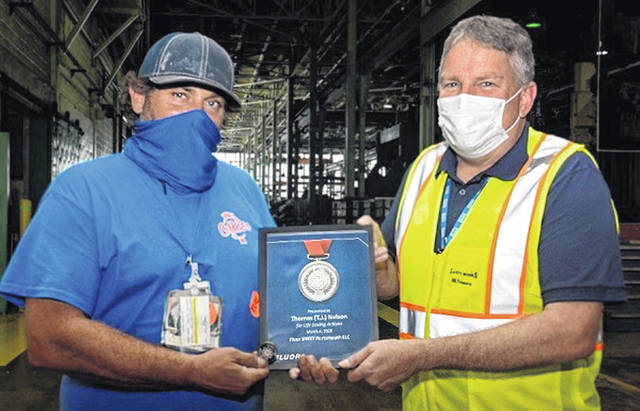 <em>Fluor-BWXT Portsmouth Site Director J.D. Dowell (right) presents T.J. Nelson with the Fluor Silver Medallion Award on Sept. 1.</em>
