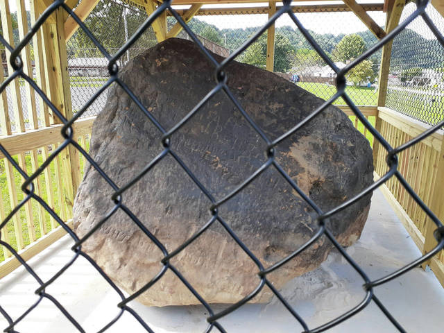 After 10 years, of sitting in a City of Greenup garage, covered by tarpaulins, the rock was moved to its location at South Shore Rotary Park for all to see.