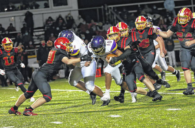 Valley sophomore quarterback Carter Nickel (10) carries downfield during the Indians' 27-21 road win over Worthington Christian in the second round of the Division VI, Region 23 football playoffs.