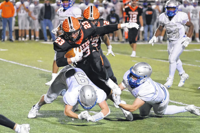 Wheelersburg junior Eli Swords (23) rushes for yardage during the Pirates' Division V Region 19 quarterfinal football playoff game against Bishop Ready last Saturday night. The Pirates play at Ridgewood on Saturday night in a Region 19 semifinal rematch from last year.