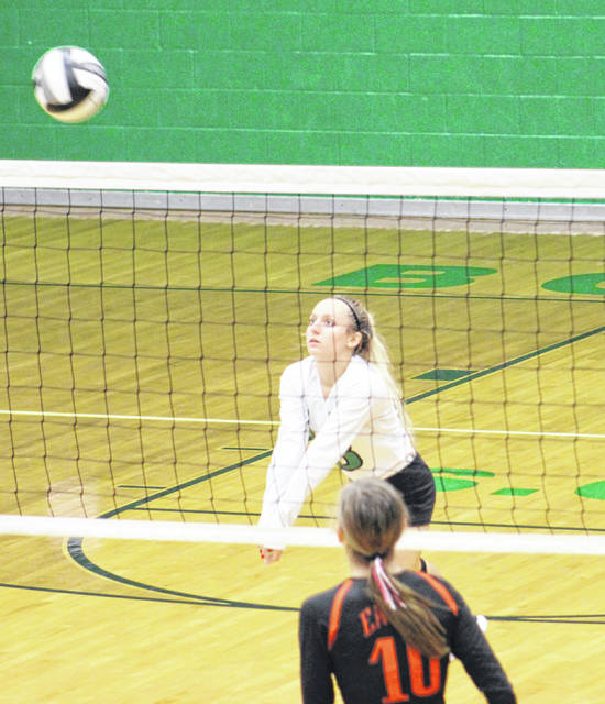Green senior libero Ava Jenkins returns a Belpre serve during Monday's Division IV sectional semifinal volleyball match at Green High School.