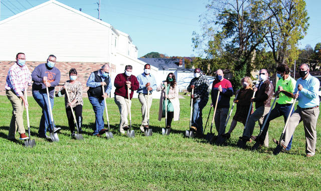 Community leaders and members met Friday to break ground for a new community garden in Portsmouth. Once construction of the garden is complete, Scioto County residents will be able to learn how to garden, take advantage of the greenhouse and enjoy fresh produce.