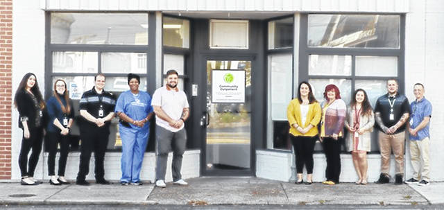 Group of employees in front of the new expansion for the Counseling Center