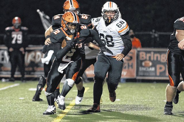 Wheelersburg sophomore running back Derrick Lattimore (2) tallied three rushing scores in the Pirates' 47-13 home win over West in the Division V, Region 19 playoffs.