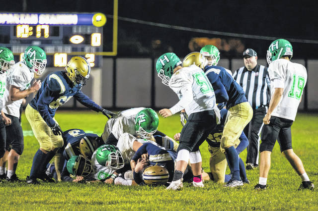 Notre Dame senior Ethan Kammer (52) recovered a Huntsmen fumble during the Titans' 41-21 home win over Huntington to conclude their 2020 football season.