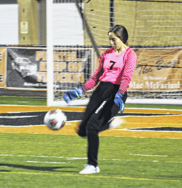Wheelersburg goalkeeper Brynley Preston (7) punts the ball away during the Lady Pirates' Division III district semifinal match on Tuesday night against Fairfield. Preston posted 13 saves, including three in the penalty-kicks shootout, as the Lady Pirates prevailed.