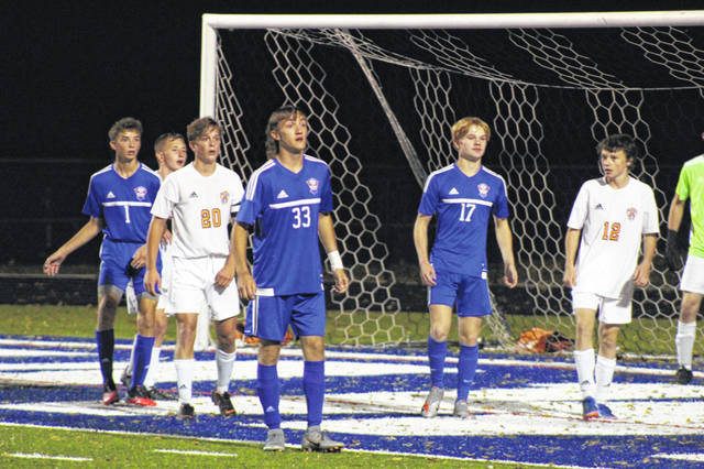 Northwest's Jay Jenkins (1), Levi Tackett (33) and Kyle Butler (17) await a Mohawk throw-in during their 0-0 draw with Waverly on Tuesday at Roy Rogers Field.