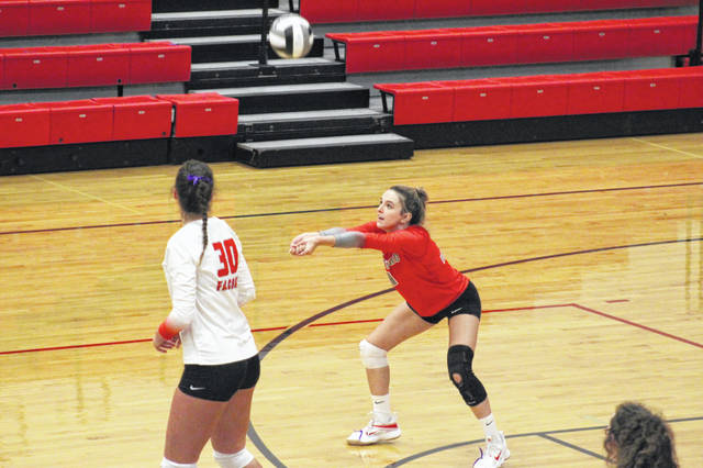 Minford senior Ezra Veach (right) attempts a dig during the Lady Falcons' three-set win over Rock Hill in a Division III sectional semifinal contest.