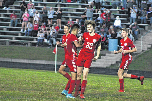 Minford junior Zane Miller (22) celebrates a New Boston own goal during the Falcons' 2-0 win over New Boston on Wednesday in a Division III sectional final contest.