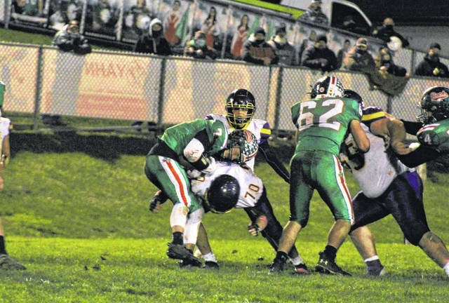 Valley senior Blake Wood (70) tackles Barnesville's Gage Hannahs in the Indians' loss to the Shamrocks in the Division VI regional quarterfinals.