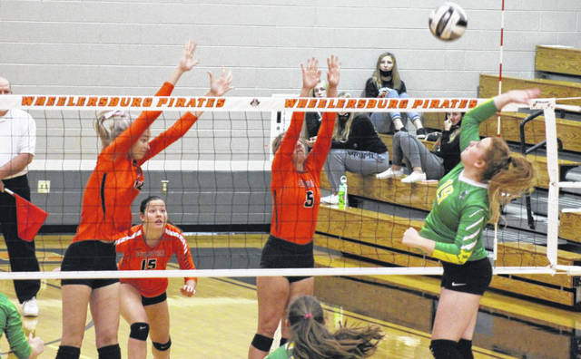 Wheelersburg seniors Kylee Barney (12), Kaylee Darnell (5) and Emily Boggs (15) combined for 27 kills in the Lady Pirates' three-set win over Meigs Eastern in a Division III district semifinal.