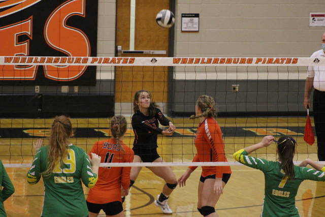 Wheelersburg sophomore libero Kiera Kennard (10) attempts a dig during the Lady Pirates' three-set sweep of Eastern Meigs in a Division III district semifinal contest at Wheelersburg High School.