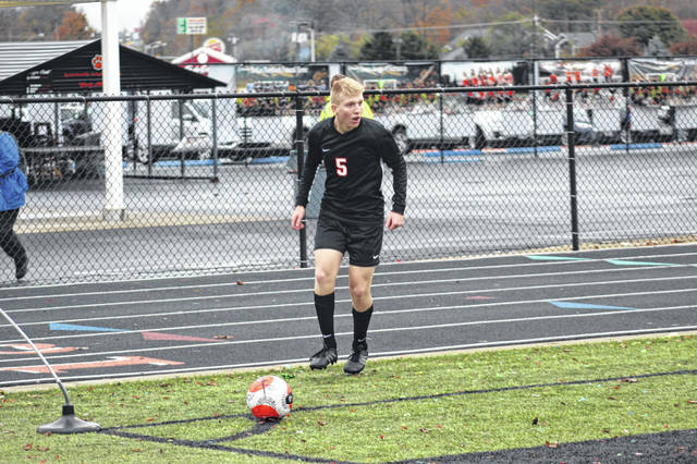 Wheelersburg junior Jacob Saxby had a corner-kick assist to senior teammate Aaron Jolly during the Pirates' district championship win over North Adams on Thursday.
