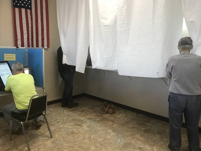 Voters casting their votes early at the Scioto County Board of Elections office on the first floor of the courthouse on Wednesday, Oct. 7.