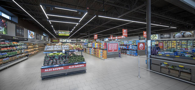The updated store features an improved layout and ample refrigeration to accommodate the recently expanded fresh and convenient food selection. The store also features open ceilings and is built with environmentally friendly materials.