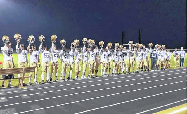 The Notre Dame Titans recognize their fans following their 38-13 football victory over Fairfield Christian on Saturday night.