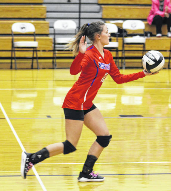 Northwest libero Lydia Emmons prepares to serve during the Lady Mohawks' Southern Ohio Conference Division II volleyball match against Wheelersburg on Tuesday.
