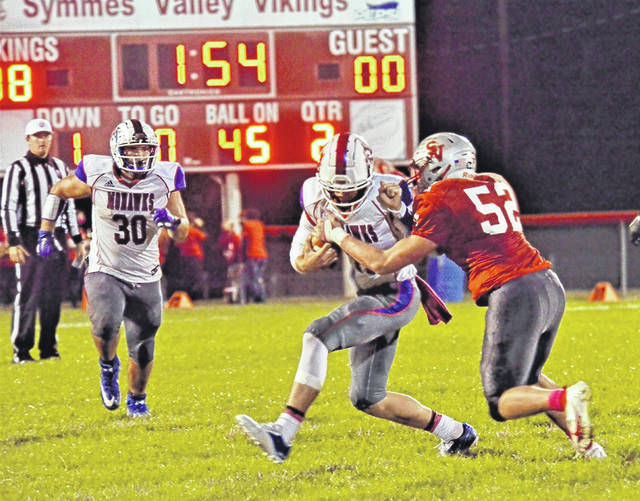 Northwest's Brayden Campbell carries the ball as Symmes Valley's Caleb Mullens (52) makes the tackle attempt during Friday night's Southern Ohio Conference Division I football game at Symmes Valley High School.
