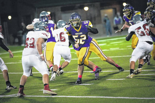 Valley senior lineman Nick Bowles (52) looks to block in the Indians' home win over Minford in SOC II play.