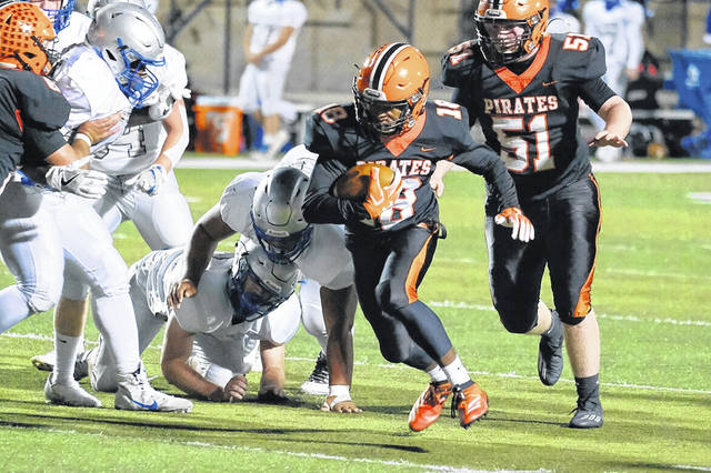 Wheelersburg sophomore Eric Lattimore (18) evades defenders during the Pirates' 31-21 win over Bishop Ready in the Division V regional quarterfinals.Mi