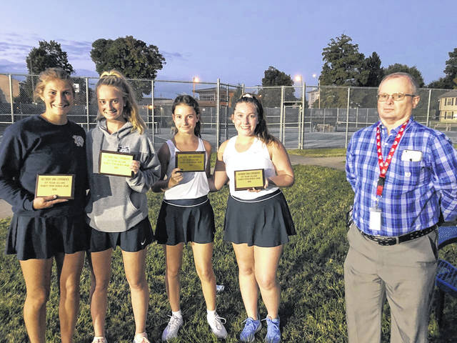 Pictured (L-R): Notre Dame's Isabel Cassidy, Ashley Holtgrewe, Savanah Holtgrewe and Mollie Creech were named to the all-Southern Ohio Conference doubles team. Presenting the award (far right) was SOC secretary/treasurer Dave Stamm.