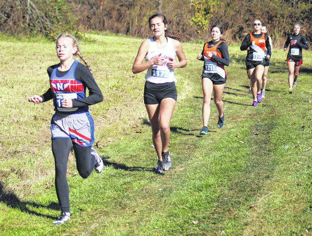 From front to back, Northwest's Kodi Burton, Minford's Juniper Allen, Wheelersburg's Amanda Salmons, Wheelersburg's Natalie Parker and South Webster's Rylee Hagen compete in the girls high school race as part of Saturday's Southern Ohio Conference championship cross country meet at Eastern High School.