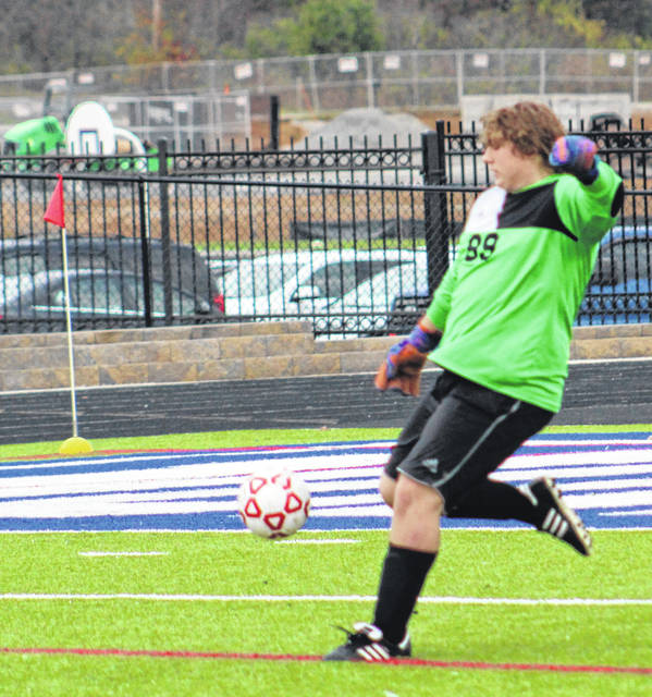 Valley senior goalkeeper Wesley Holbrook punts the ball during the Indians' Division III boys soccer sectional championship match against Northwest on Wednesday at Northwest High School's Roy Rogers Field.