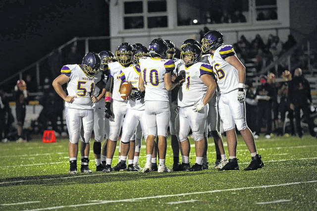 Valley quarterback Carter Nickel (10) relays instructions to the Indians' offense during their 27-21 comeback road win over Worthington Christian in the Division VI, Region 23 state playoffs.