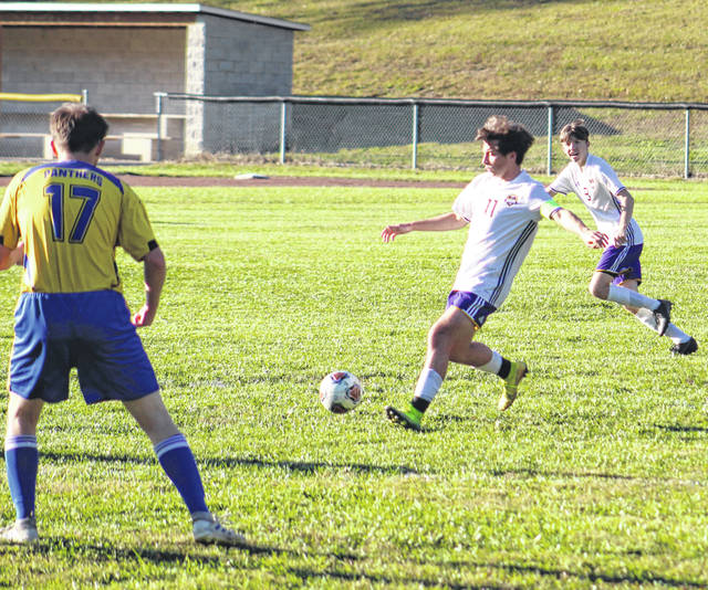 Valley senior A.J. Johnson (11) attempts a pass during the Indians' Southern Ohio Conference Division I boys soccer match against Clay on Thursday at Clay High School.