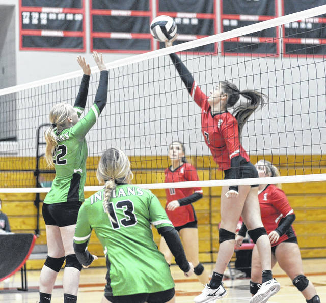 South Webster's Natalie Adkins (7) goes up for a kill over Western's Sakayla Beckett (22) during Thursday's Division IV district semifinal volleyball match at South Webster High School.