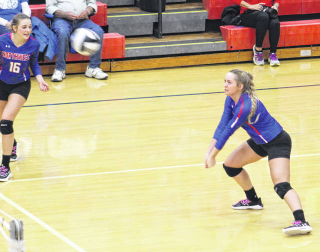 Northwest senior Terah Webb (3) returns a Zane Trace serve as Ava Jenkins (16) looks on during the Mohawks' Division III district semifinal match on Wednesday.