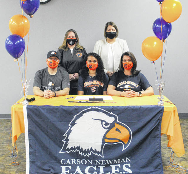Wheelersburg High School senior Boo Sturgill, seated center, announces her intention to play college softball for Carson-Newman University. Seated with Sturgill are father Ryan Morrow (left) and mother Stephanie Morrow (right); standing are Wheelersburg High School assistant softball coach Susan Reutzel (left) and Wheelersburg High School head softball coach Teresa Ruby (right).