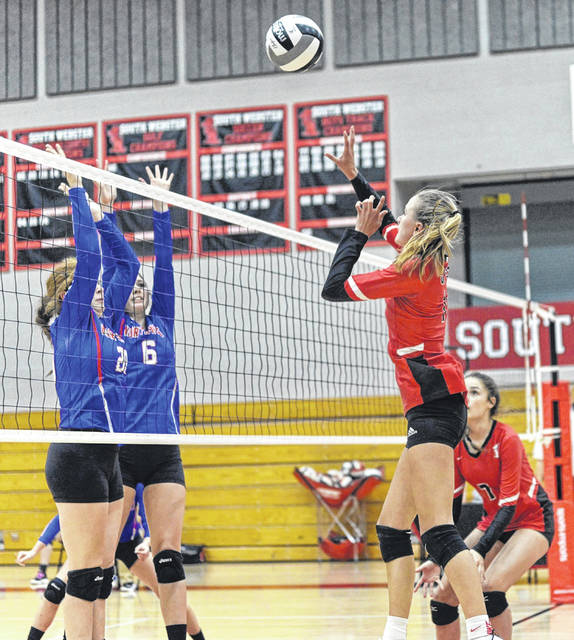 South Webster junior Bri Claxon (1) attempts a kill during the Lady Jeeps' three-set win over Northwest to clinch the program's first share of a Southern Ohio Conference Division II title since 2011.