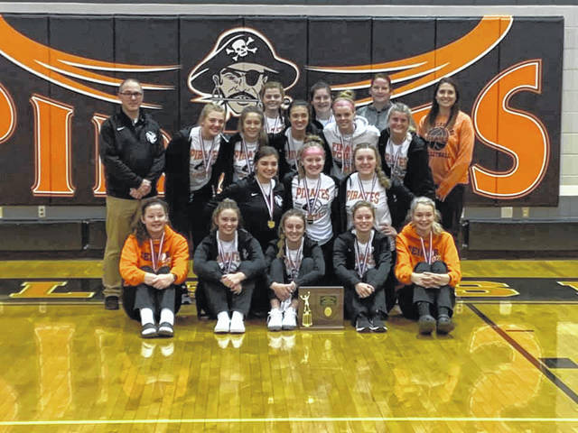 The Wheelersburg Lady Pirates volleyball program won their fourth consecutive Division III district championship with a three-set sweep over Nelsonville-York.