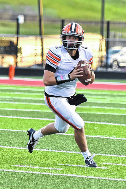 Ironton quarterback Tayden Carpenter completed 5-of-12 passes for 46 yards, including the game-winning 23-yard touchdown pass to Reid Carrico, in the Fighting Tigers' 22-19 victory over Roger Bacon in Saturday night's Division V state semifinal at London High School.