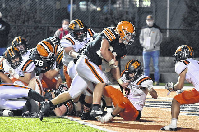 Ironton senior Reid Carrico (28) scored both of the Fighting Tigers' touchdowns in their 17-7 victory over Ridgewood in Saturday's Division V Region 19 championship game.